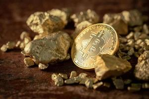 Gold bitcoin physical Bitcoin Cryptocurrency and Gold nugget grains photo