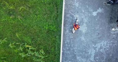 Aerial drone view of a man riding his motocross motorcycle. video