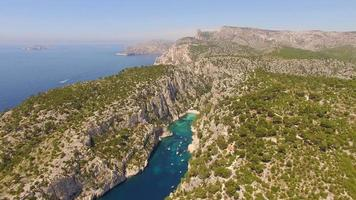 Aerial travel drone view of clear green water and cliffs of Cassis, Mediterranean Sea, Southern France. video
