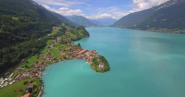 Aerial travel drone view of Iseltwald, Lake Brienz, Switzerland. video