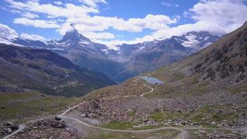 Aerial travel drone view of Zermatt at the Stellisee Lake, Mount Matterhorn, Switzerland. video