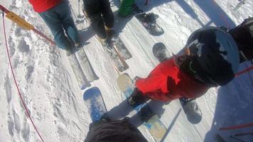 POV of snowboarders on a ski lift at a ski resort. video