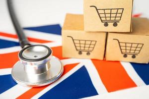 Shopping cart logo with United Kingdom flag, Shopping online Import Export eCommerce finance business concept. photo
