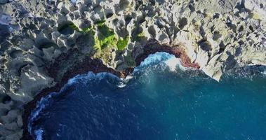Aerial drone view of rocky tide pools coastline. video