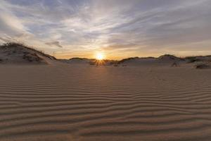Landscape with sunset in the desert photo
