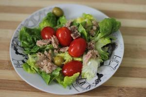 fresh salad with tuna, cherry tomatoes, olives, iceberg photo