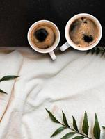 Closeup black coffee cup put on linen fabric. top view photo