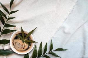 Cannabis coffee put on linen fabric, top view photo