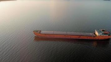 An Orange Barge Floating Down the River video