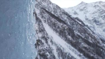 A frozen waterfall drips and rains in the mountains. video