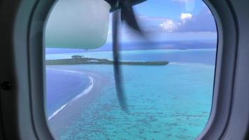 POV passenger view out an airplane window of tropical islands in French Polynesia. video
