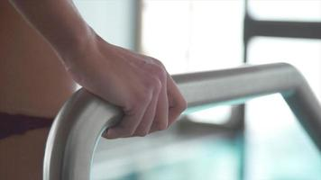 Close-up of a woman hand stepping into a pool at a luxury spa resort. video