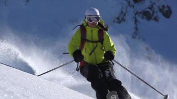 A woman skiing on powder snow covered mountains. video