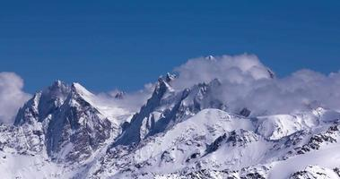 Timelapse of clouds flowing over a mountain range. video