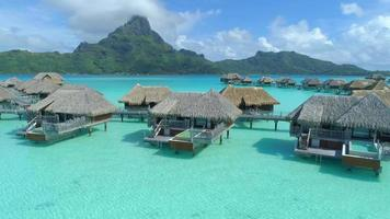 Aerial drone view of a luxury resort and overwater bungalows in Bora Bora tropical island. video