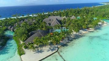 Aerial drone view of a luxury resort and pool in Bora Bora tropical island. video