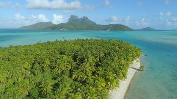 Aerial drone view of a deserted island near Bora Bora tropical island. video