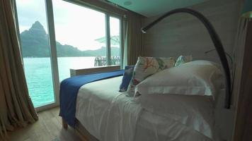 A bedroom in a luxury resort hotel room at a tropical island resort. video