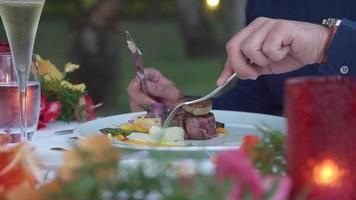A man dining at dinner at a tropical island resort. video