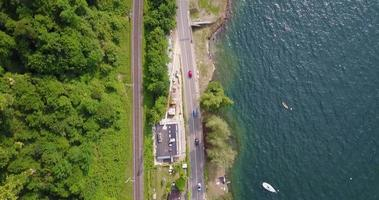 Aerial drone view of cars driving in a town near Lake Maggiore, Switzerland. video