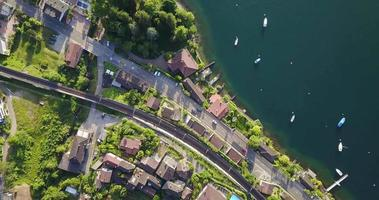 Aerial drone view of a town with train tracks near Lake Maggiore, Switzerland. video