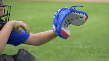 Boy catcher throwing the baseball in a little league game with mask. video