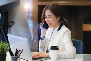 Business woman using computer laptop photo