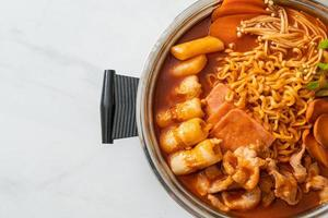 Budae Jjigae or Budaejjigae Army stew or Army base stew - It is loaded with Kimchi, spam, sausages, ramen noodles and much more photo