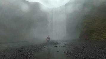 A man hiking near Skogafoss waterfall in Iceland, Europe. video
