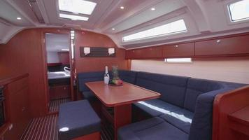 Interior dining room on a sailboat boat. video