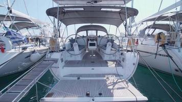 Exterior view of a fold down sailboat boat swim platform step deck. video