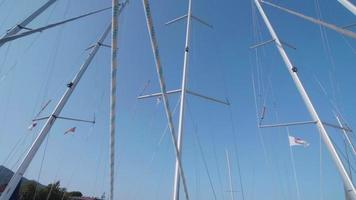 Exterior view of a sailboat mast and boat deck. video