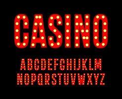 letras rojas con bombillas. alfabeto alto y estrecho. Fuente para póster de casino de cine, decoración de carnaval y festivales, logotipos de clubes nocturnos de juegos de azar. diseño de tipografía vectorial vector