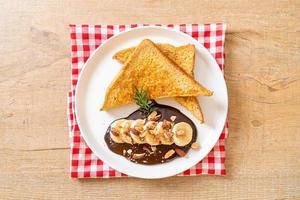 French toast with banana chocolate almonds photo