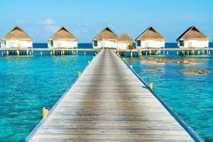 Beautiful tropical Maldives resort hotel and island with beach and sea photo