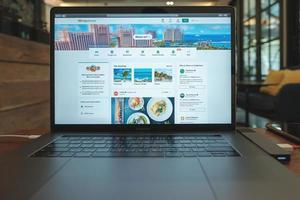 Chiang Mai, Thailand 2019-  Macbook pro with Tripadvisor website on screen photo