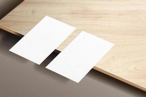 Minimalist business card mockup isolated on wooden plat background. photo