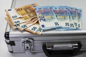 50 and 20 euro banknotes on aluminum case photo