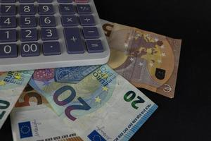 banknotes with calculator for counting photo