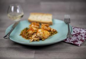 cuttlefish and peas dish composition photo