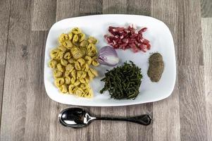 ingradients for cappelletti, bacon and asparagus photo