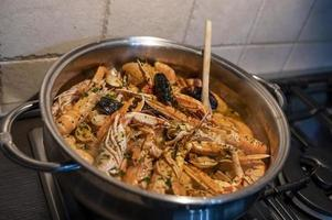 fresh fish soup with scampi and seafood photo