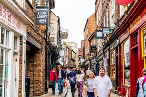York, UK - SEP 3, 2019 - a little street in Shambles market, where is inspired by Diagon Alley, in York, UK photo