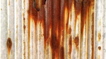 Textura y fondo de la vieja pared de zinc oxidado. foto