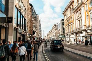 London, England -2 SEP 2019 - The famous Oxford Circus with Oxford Street and Regent Street on a busy day photo