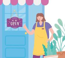 we are open sign, happy employee woman with apron door with hanging signboard and plants vector