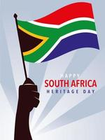 happy South African heritage day, hands holding flag of South Africa vector
