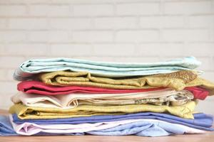 Close up of stack of clothes on table photo