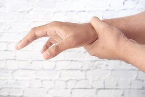 Man suffering pain in hand close up photo