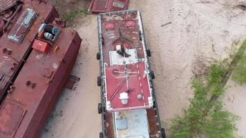 Old rusty ships on the riverbank on the sand Aerial filming video
